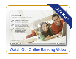 Happy couple laying down on sofa while watching online banking training videos