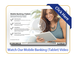 Woman smiling while watching First State Bank of Newcastles education videos on her tablet
