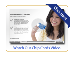 Woman smiling and holding up a debit card